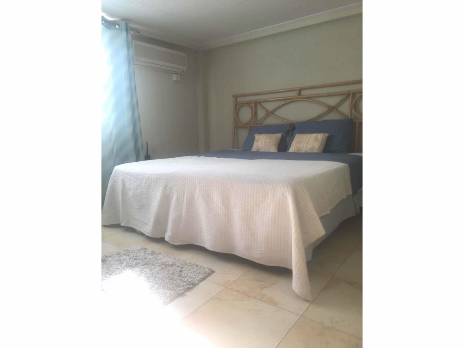Spacious bedroom with double bed, A/C and built-in wardrobe