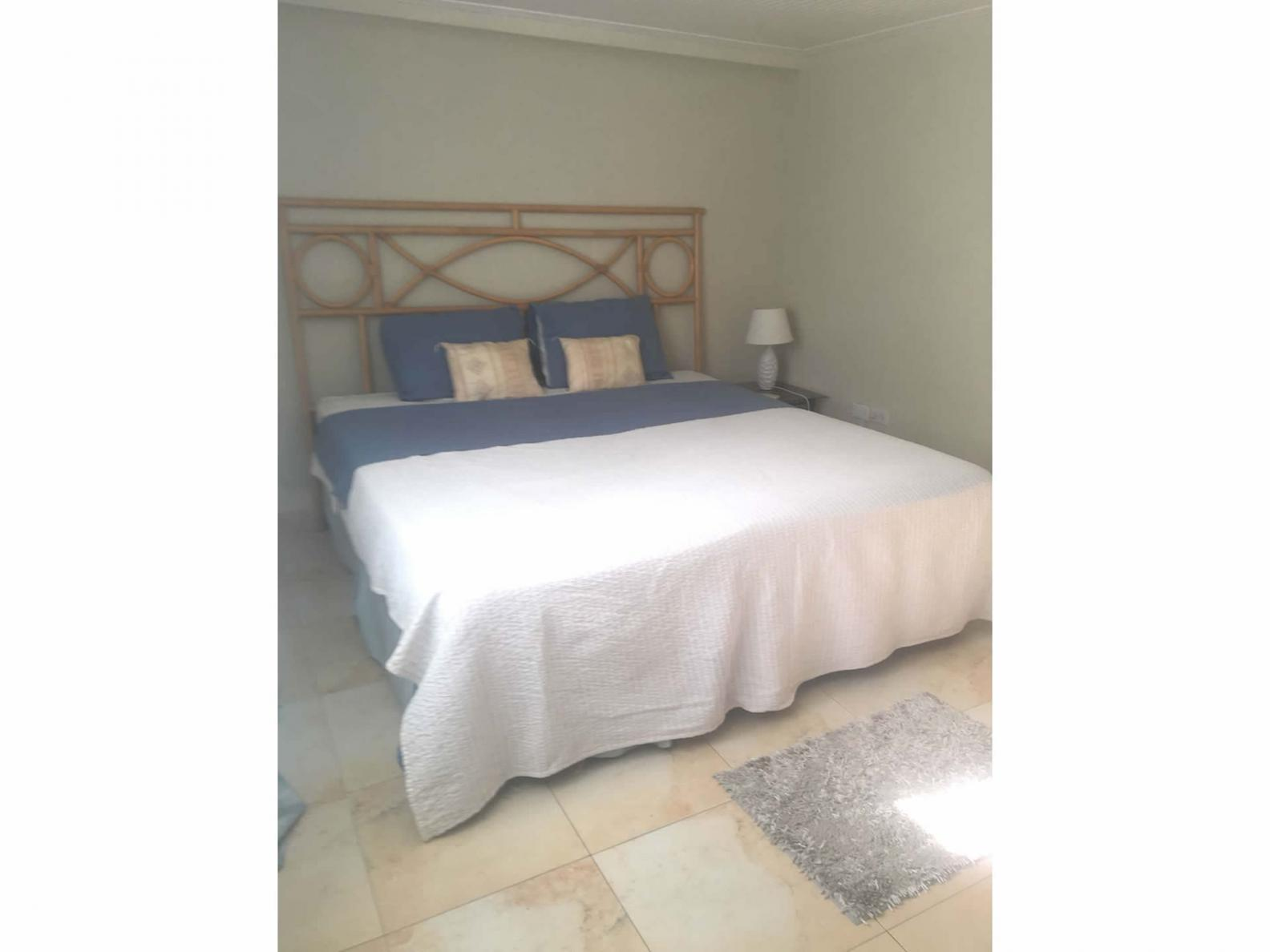 Spacious bedroom with a double bed, A/C and built - in wardrobe