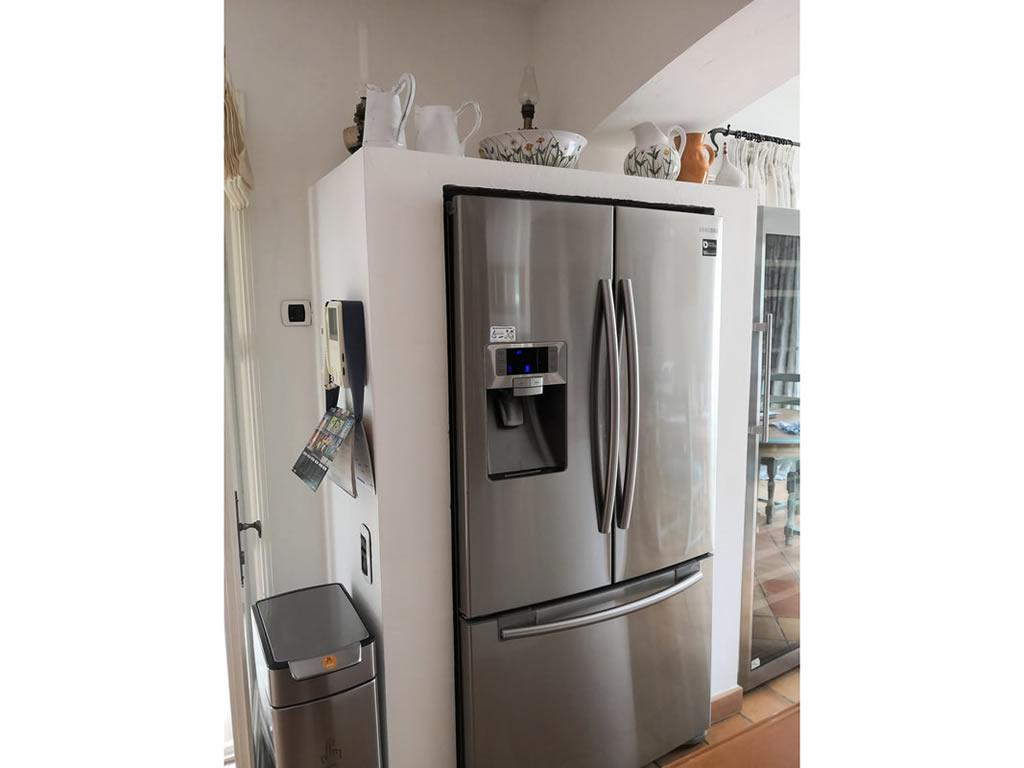 New fridge/freezer with ice maker in the kitchen