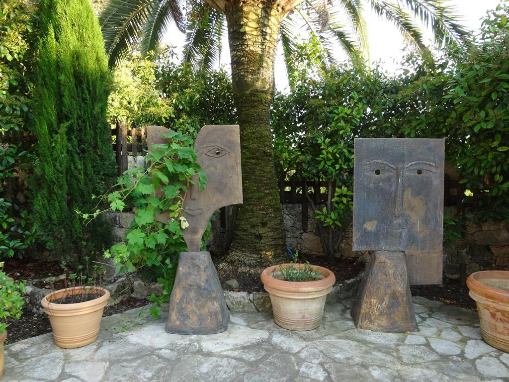 Well maintained garden with beautiful plants and garden sculptures
