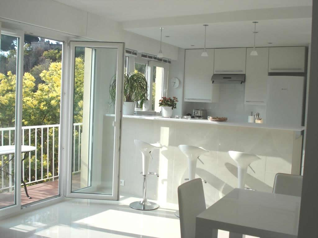 Open plan lounge / kitchen with a double glazed door leading to the balcony