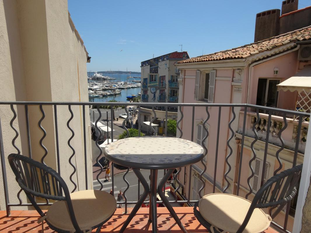 Beautiful panoramic balcony overlooking the Old Port of Cannes and Palais des Festival to the left.
