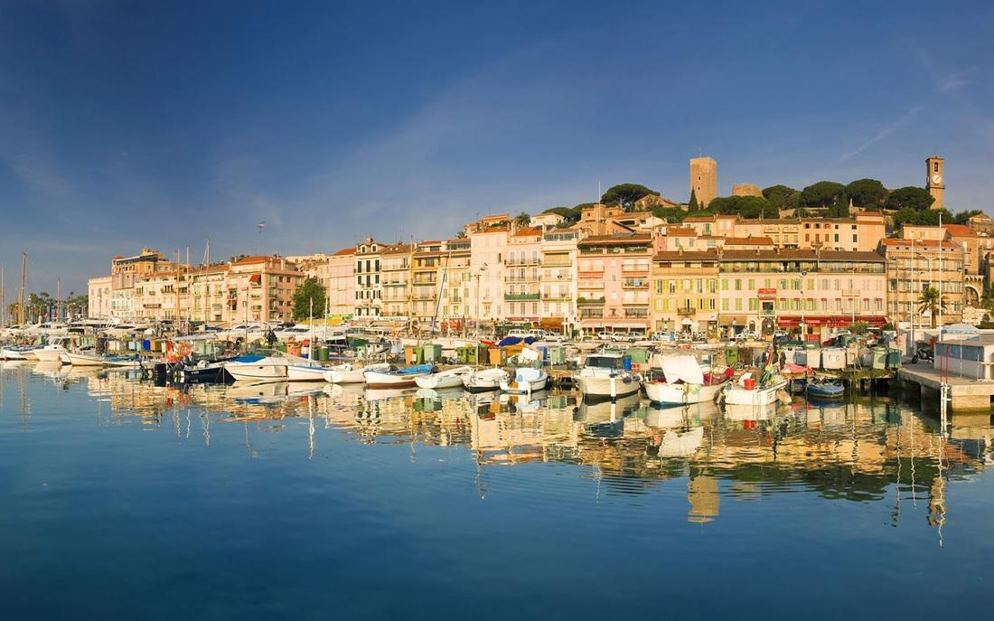 The beautiful view of Cannes Old port and the marina - only a minute walk from the apartment